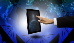hand of businessman pointing to tablet with satelite dish and world map